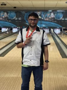 Chris holding his bowling medal